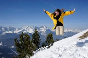 Snow. Girl jumping and happy to be in the snow. (photo via/Flickr Saffron Blaze)