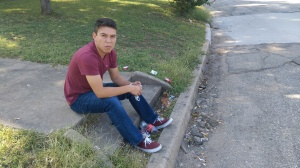 Abraham Basurto at the smoking spot on University Circle with cigarette liter at his feet.
