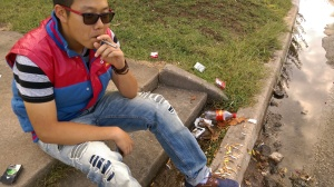 Yizhe Peng smoking his vapor cigarette on University Circle.