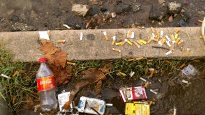 The smoking step on University Circle littered with cigarette butts, bottles and cigarette cartreges.